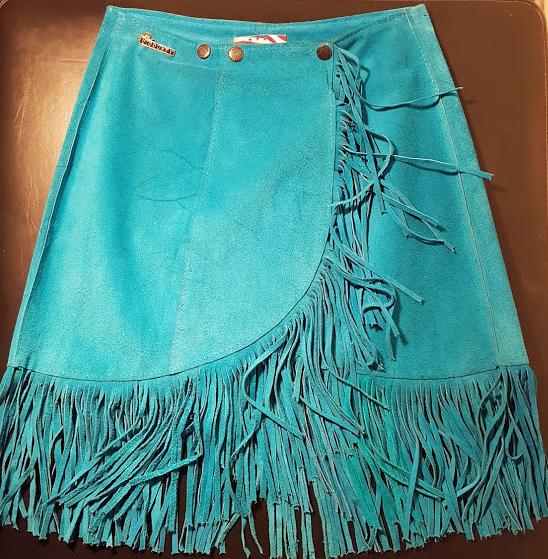 Jupe cuir bleue avec des franges